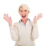 Medio leeftijdsvrouw die verrast kijken Royalty-vrije Stock Afbeelding