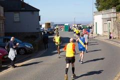 Weston Super half marathon at Weston-super-Mare, Somerset on Sunday 24th March 2019 runners at Birnbeck Rd