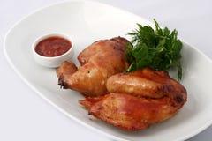 Medio pollo asado con la ensalada imagen de archivo libre de regalías
