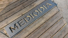 Mediodia, 12 o'clock in the daytime. Beautiful urban sign with text in Spanish mediodianoon,  12 o'clock in the daytime Stock Photos