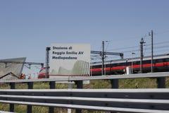 Mediopadana railway station. REGGIO EMILIA, ITALY - MAY 14, 2014: fast train Frecciarossa enter the modern Railway station Mediopadana Royalty Free Stock Photography