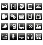 Medios iconos blancos en casillas negras Fotos de archivo libres de regalías