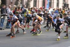Medios patinadores del rodillo del maratón Imagen de archivo libre de regalías