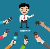 Medios que conducen una entrevista de la prensa Fotos de archivo