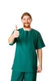 Medique mostrar do homem os polegares acima ou ESTÁ BEM Imagem de Stock Royalty Free
