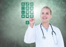 Medique o toque de ícones médicos digitalmente gerados contra o fundo branco Imagens de Stock Royalty Free