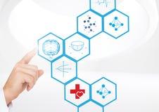 Medique o toque de ícones médicos digitalmente gerados contra o fundo branco Fotos de Stock Royalty Free