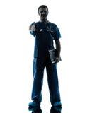 Medique a silhueta do homem que está o comprimento completo que gesticula o aperto de mão Foto de Stock Royalty Free