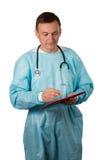 Medische arts met stethoscoop die een pen houden en in n schrijven Royalty-vrije Stock Foto's