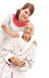 Medische behandeling voor een oude vrouw Stock Afbeeldingen