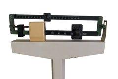 Medische die Gewichtsschaal op wit wordt geïsoleerd stock fotografie