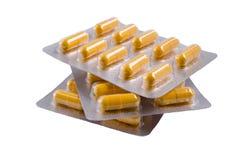 Medische gele capsules royalty-vrije stock foto's