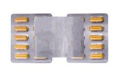 Medische gele capsules royalty-vrije stock afbeeldingen