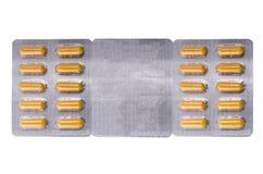 Medische gele capsules stock afbeelding