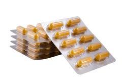 Medische gele capsules stock afbeeldingen