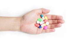Medische in hand van de apotheekgeneeskunde Stock Foto