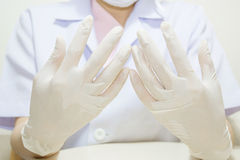 Medische handschoen aan bescherming Royalty-vrije Stock Foto's