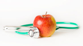 Medische stethoscoop en appel Stock Foto