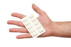 Medische tabletten in zijn hand Royalty-vrije Stock Fotografie