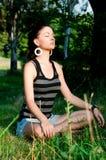 Meditação da mulher nova Fotografia de Stock Royalty Free