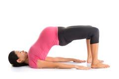 Meditación de la yoga de la mujer embarazada Foto de archivo libre de regalías
