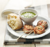 Meditarian meat skewers served with bread and pesto Royalty Free Stock Photos