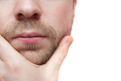 Meditatamente sfregare il suo mento Fotografia Stock