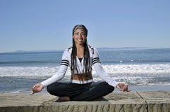 Meditate by the beach Stock Images