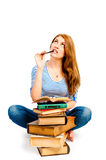 Meditate beautiful student with pile of books Royalty Free Stock Photography