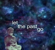 Meditate and Let the Past Go Word Cloud. Dark night sky deep space background with a meditating seated Buddha statue and LET THE PAST GO word cloud drifting away Stock Photos