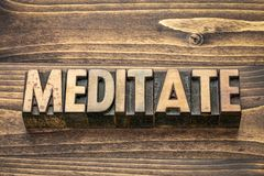 Meditate word in wood type royalty free stock photo