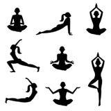 Meditatiesilhouetten op de witte achtergrond Stock Foto