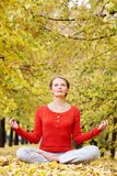 Meditating in autumn Royalty Free Stock Photos