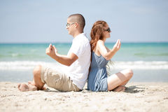 Meditating at the beach Royalty Free Stock Image