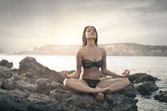 Meditating on the beach Royalty Free Stock Image