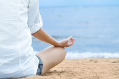 Meditating on the beach Stock Photography