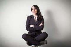 Meditating beautiful young businesswoman Royalty Free Stock Image