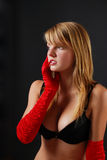 Meditating blond woman in red gloves Royalty Free Stock Images