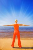 Meditating blong girl. Blond girl meditating on the beach Royalty Free Stock Photos