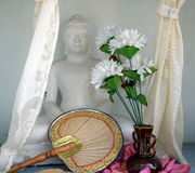 Meditating Buddha with Fan and Vase of White Flowers, Sri Lanka. The photographer was privileged to be invited to a Buddhist temple and home of Buddhist monks in Stock Photos
