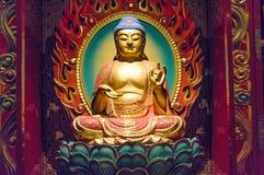 Meditating Buddha figurine at Buddha Tooth Relic Museum in Singa Stock Photos