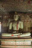 Meditating Buddha statue in Dambulla Cave Temple, Sri Lanka Royalty Free Stock Image