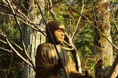 Meditating Buddha in woods, Kyoto Japan. Royalty Free Stock Photography