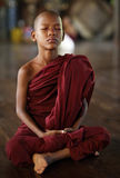 Meditating Buddhist novice in Yangon, Myanmar. Stock Photography