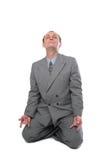 Meditating business man Stock Photo