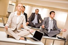 Meditating business partners Stock Images