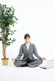 Meditating business woman Stock Photography