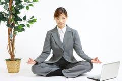 Meditating business woman Stock Photo