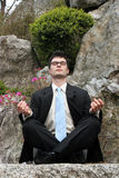 Meditating businessman Royalty Free Stock Photos