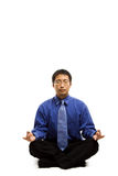 Meditating businessman Royalty Free Stock Image